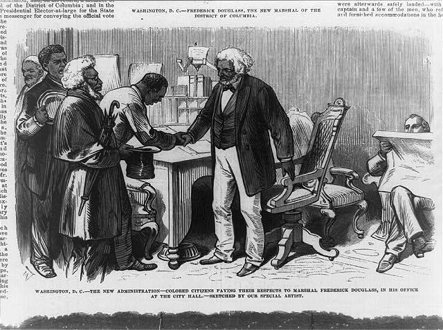 Washington, D.C.--the new administration--colored citizens paying their respects to Marshall Frederick Douglass, in his office at the city hall