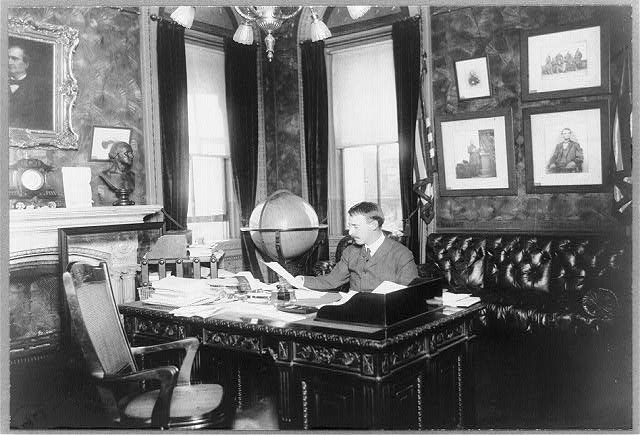 [Henry L. Stimson, half-length portrait, seated at desk, facing slightly left]