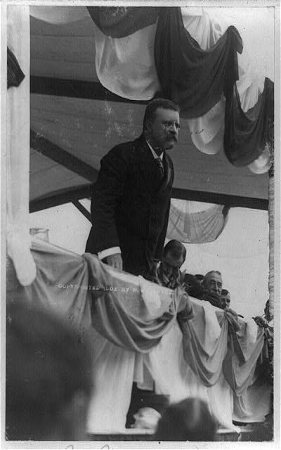 [Theodore Roosevelt, half-length portrait, standing, facing right, making speech at Worcester, Mass.]