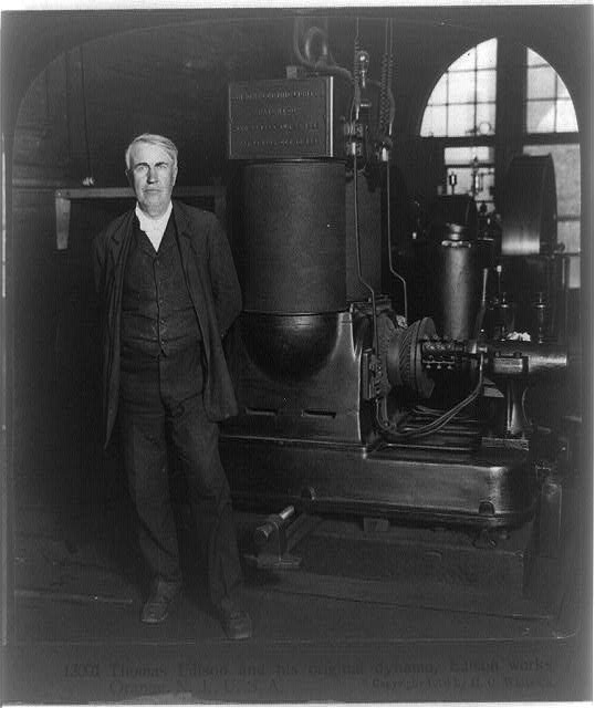 Thomas Edison and his original dynamo, Edison Works, Orange, N.J., U.S.A.