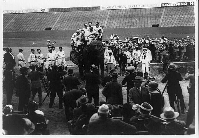 [Members of the Republican team of the House of Representatives parading with an elephant before start of House of Representatives baseball game at American League park]