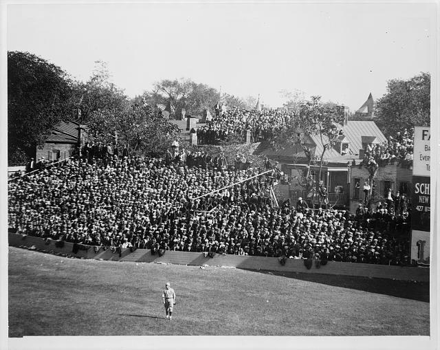 [Baseball game at old Griffith Stadium, Washington, D.C., view of spectators and one player on field]