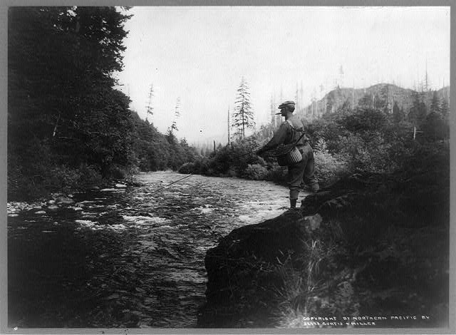 [Fisherman with cigar on rocks above Green River, Washington]