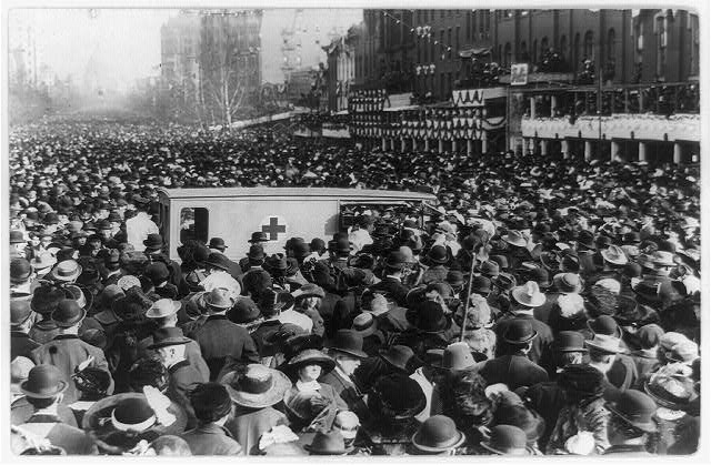 [Women's suffrage procession in Washington, D.C. 1913, March 3, crowd around Red Cross ambulance]