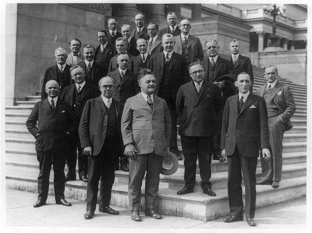 [Twenty-three members of the U.S. House of Representatives who are members of Rotary Clubs posed on steps of the U.S. Capitol after having their rotary luncheon]