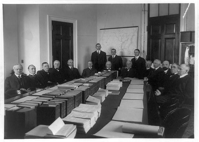 [Committee on Rivers and Harbors, 16 men around table]