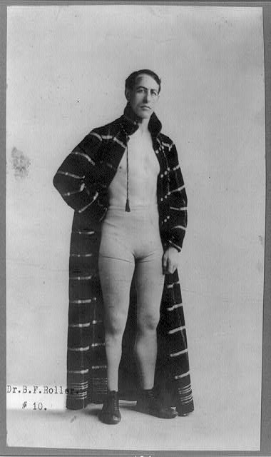 [Dr. B.F. Roller, full-length portrait, standing, facing right, wearing boxing shorts and robe]