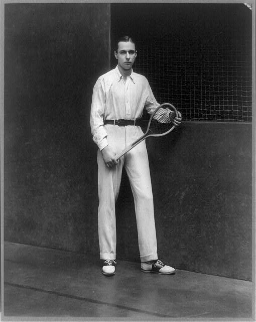 [George Jay Gould, full-length portrait, standing, facing right, holding racket]
