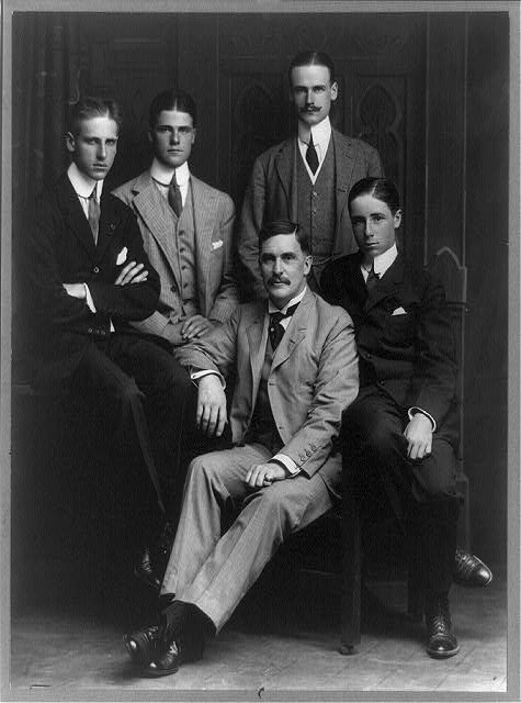 [Thomas Mott Osborne, full-length portrait, seated, facing left, and his four sons]