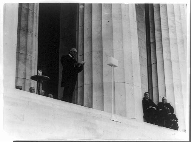 [President Warren G. Harding making speech from top of steps at dedication of the Lincoln Memorial]