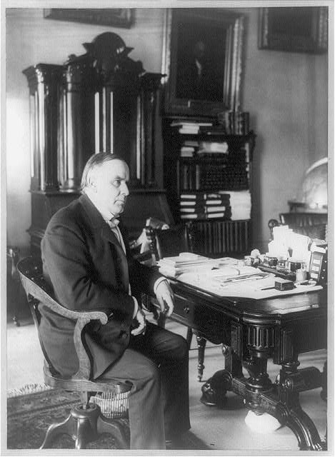[William McKinley, full-length portrait, seated at desk, facing right, June 7, 1898]