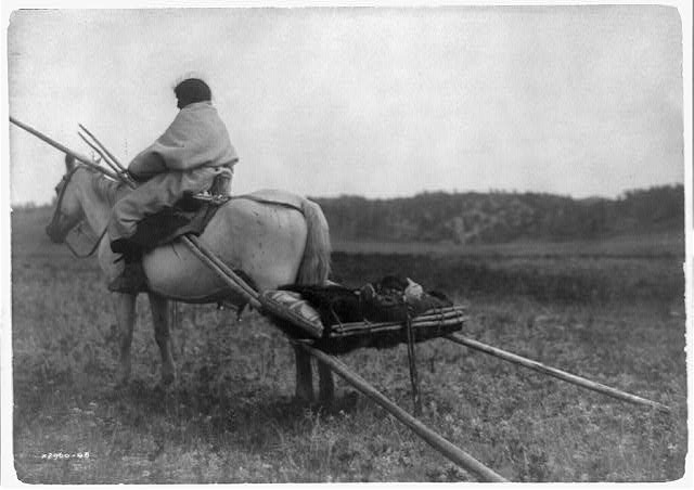[Atsina Indian on horse pulling travois]