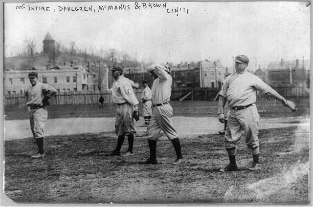"[Harry McIntire, Dahlgren, Joab Logan ""Joe"" McManus, and Mordecai ""Three Fingers"" Brown of Cincinnati baseball team on field]"