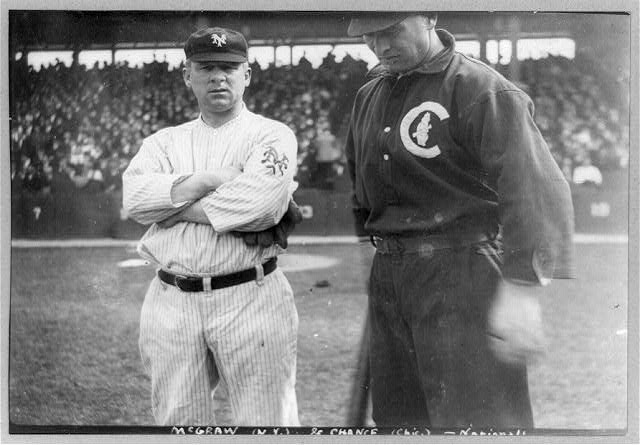 [Baseball players John J. McGraw of N.Y. and Frank Chance of Chicago National League baseball, standing beside each other on baseball field]