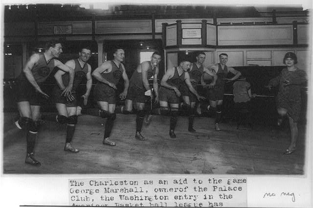 [Miss Vivian Marinelli giving lesson in dancing the Charleston to basketball players of Washington, D.C.'s Palace Club: Jones, Conway, Grody, Saunders, Kearns, Glascoe, and Manager Kennedy]