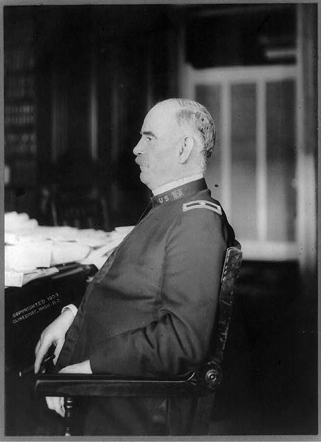 [George B. Davis, half-length portrait, seated at desk, left profile, in uniform]