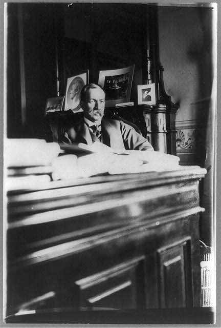 [David Jayne Hill, 1st Assistant, State Department, half-length portrait, seated at desk, facing right]