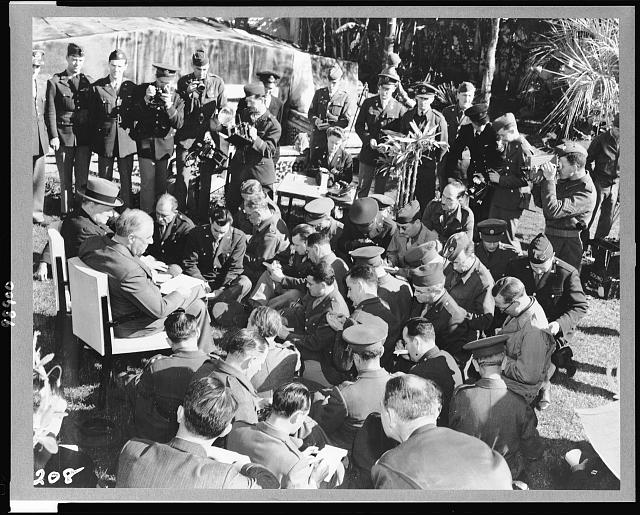 "Casablanca Conference at Casablanca, French Morocco, Africa. The ""unconditional surrender"" announcement. President Roosevelt, with Prime Minister Winston Churchill at his side, reading to the assembled war correspondents"