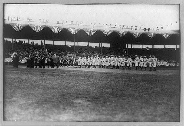 [Baseball, opening day showing Brooklyn team and band on stadium field]