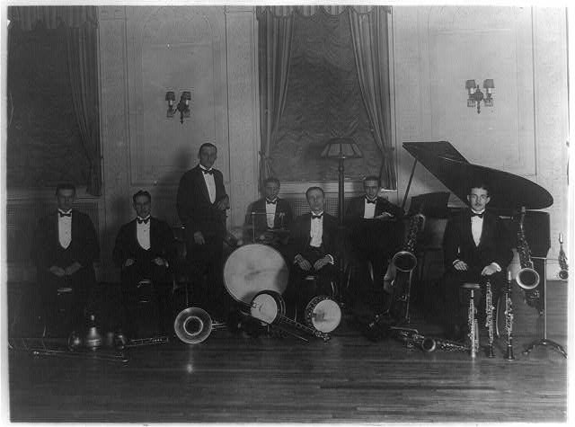 [Group of seven musicians including Charlie Miller, Elwood Wilson, and Robert Blatt, probably members of a Washington, D.C. orchestra, in a hotel at 2400 16th St., N.W.]