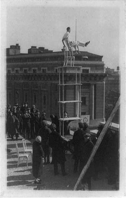 "The ""Human fly"" otherwise known as John Reynolds giving an exhibition of his skill on the roof of the Times-Herald Bldg. Wash[ington] D.C."