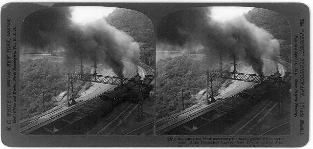 Rounding the bend, ascending the heavy grades (90 ft. to the mile) of the Horseshoe Curve, Penn. R'y, Allegheny Mts., Pa., U.S.A.