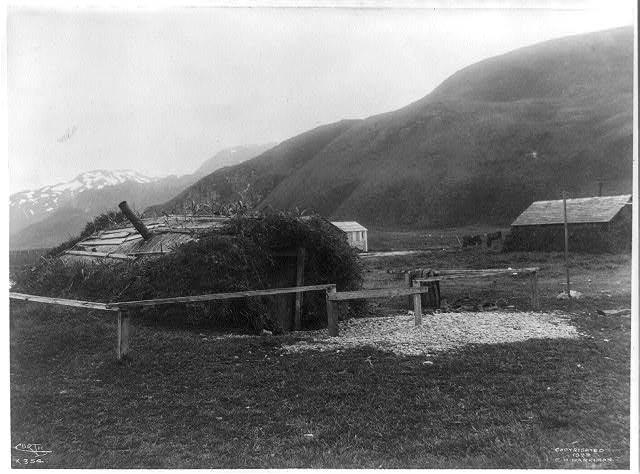 [Aleutian Islands? : Earthen hut with fence]