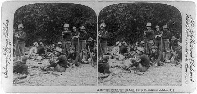 A short rest on the fighting line - during the battle at Malabon, Philippine Islands