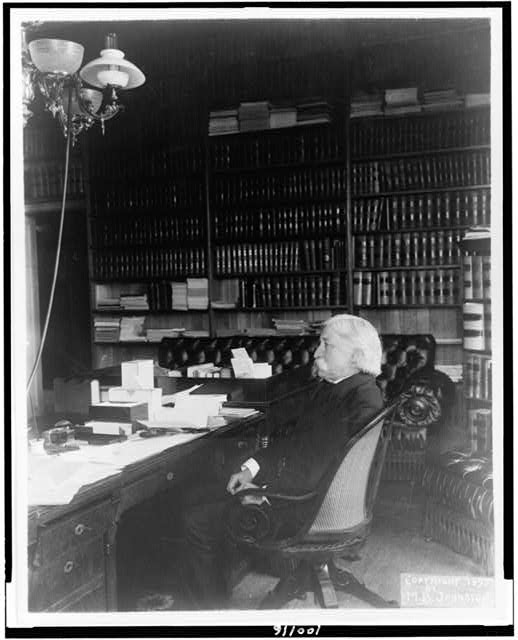 [Melville Weston Fuller, full-length portrait, seated at desk, facing left]