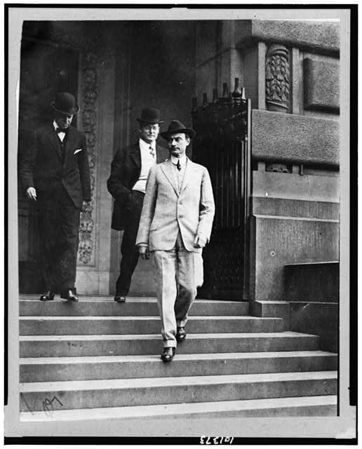 [John Purroy Mitchel, full-length, facing left, walking down steps with two other men]