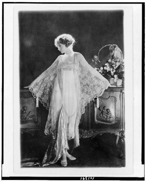 [Lillian Gish, full-length portrait, standing, facing left, wearing pink morning gown of chiffon and lace]