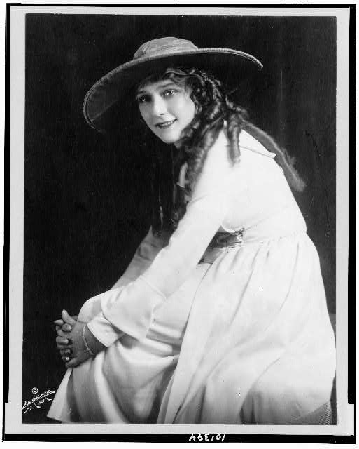 [Mary Pickford, three-quarter length portrait, seated, facing left]