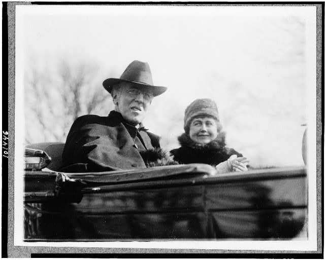 [President Woodrow Wilson, half-length portrait, facing right, in automobile, with his second wife]