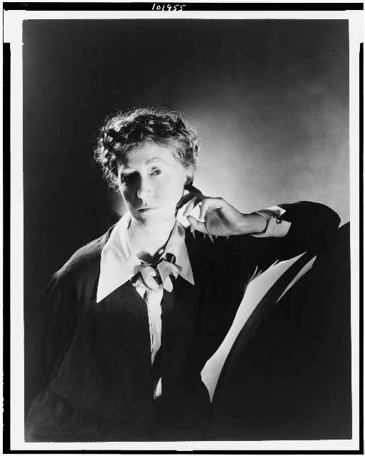 [Marianne Moore, half-length portrait, facing left]