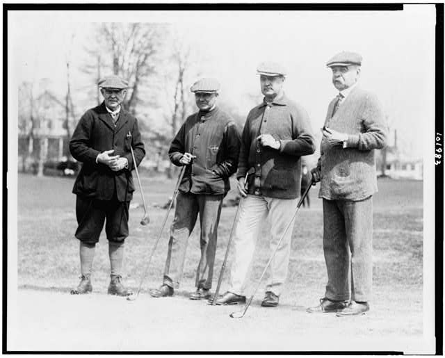 [Left to right: Secty. of Interior Judge John Barton Payne, Moreven(?) Thompson of Washington, D.C., Secty. of Treasury David Franklin Houston, ex-Senator Willard Saulsbury, photographed at the Chevy Chase Club, Chevy Chase, Maryland]