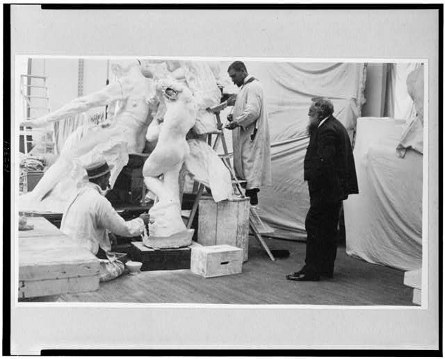 [Auguste Rodin observing work on the Monument to Victor Hugo, Lebossé's studio, 1896]
