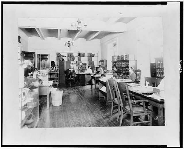 Reading room for the blind in the Library of Congress, where books and magazines in braille or moon type are always on hand. Several employees of this division are blind
