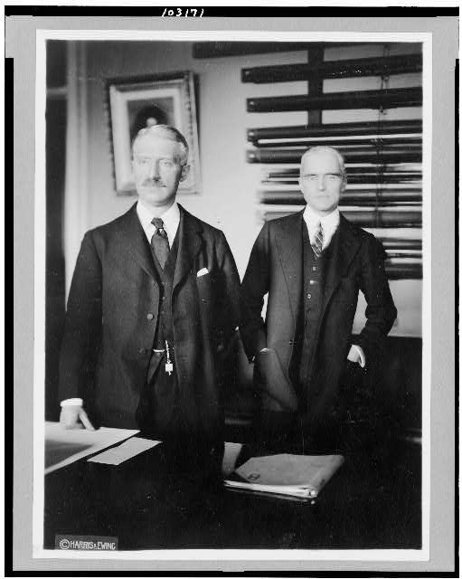 [Bainbridge Colby, Secretary of State, and Frank Polk Asst. Sec. of State, posed, standing, three-quarter-length]