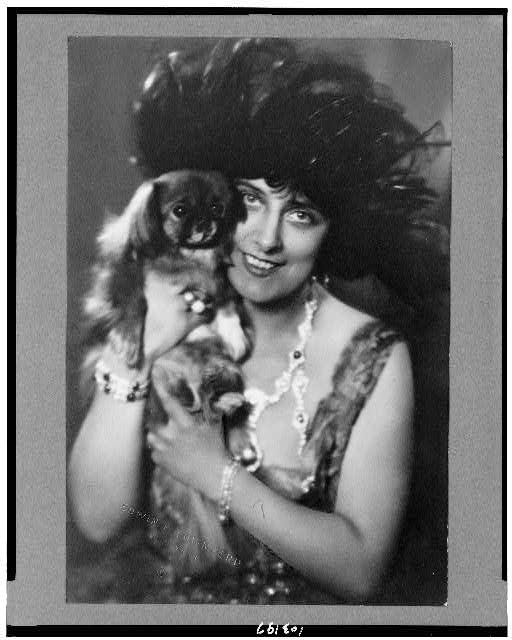 [Geraldine Farrar, half-length portrait, facing front, holding dog]