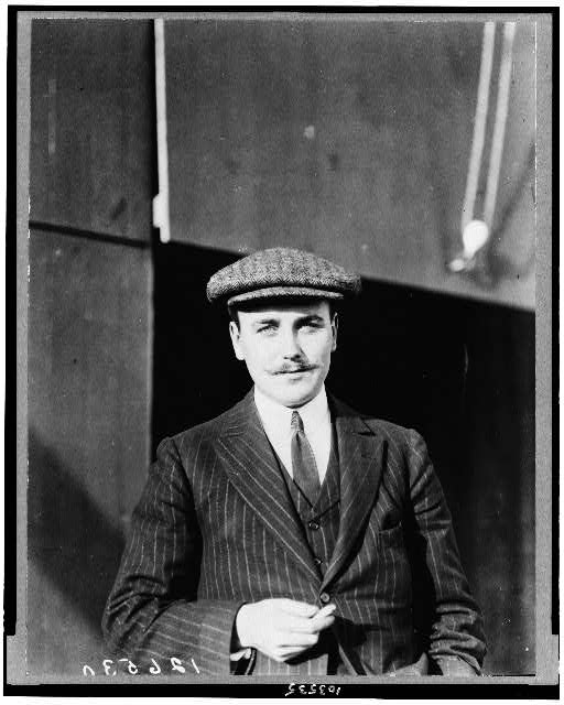 [Anthony J. Drexel, Jr., millionaire aviator, half-length portrait, standing, facing forward, wearing cap]