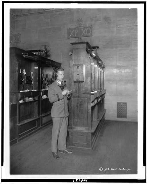 [Telephone operator at booth, new quotation system, New York Stock Exchange]