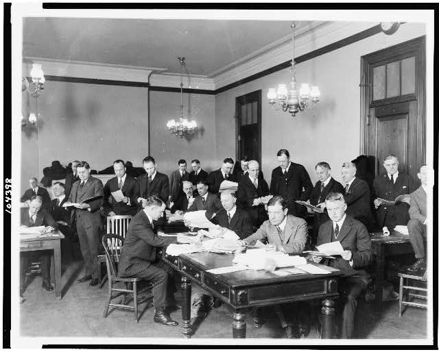 Committee on Elections of the Senate engaged in the counting of the Ford-Newberry vote. Tellers in the foreground of the picture are Senators Walter E. Edge of N.J. and Selden P. Spencer of Mo.
