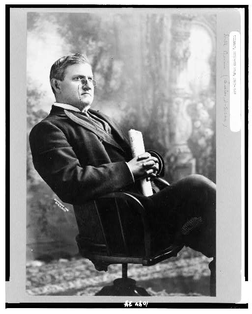 [Benjamin Ryan Tillman, three-quarter length portrait, seated, facing right holding the Washington Post]