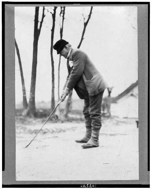 [John Marshall Harlan golfing, full-length portrait, standing, facing left]