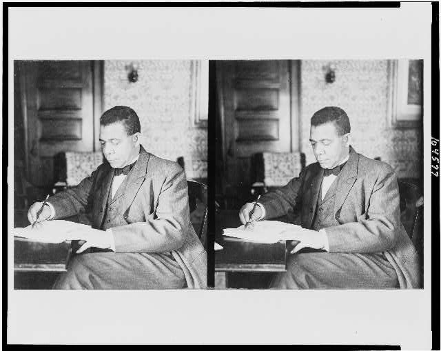 [Booker T. Washington, three-quarter length portrait, seated, facing left, writing]