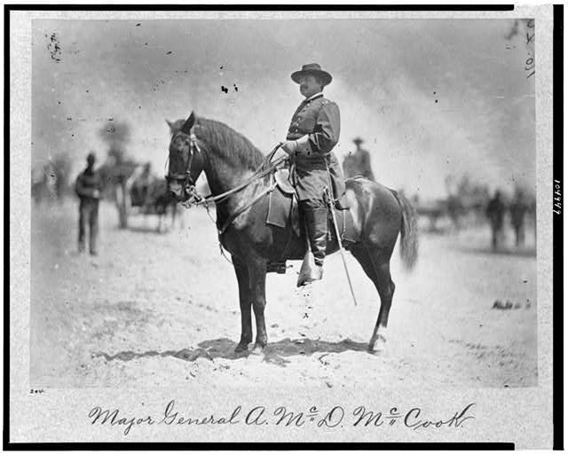 [Major General Alexander McDowell McCook, full-length portrait seated on horseback, facing left]
