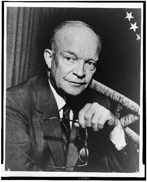 [Dwight D. Eisenhower, half-length portrait, facing slightly right, holding glasses]