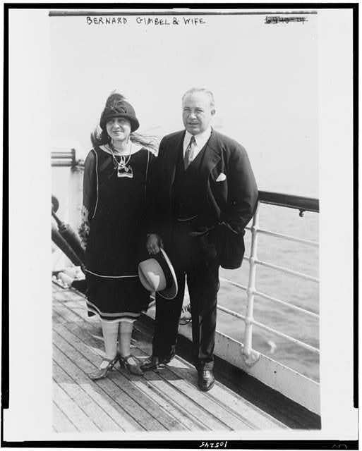 [Bernard F. Gimbel, merchant, standing, full-length with wife]