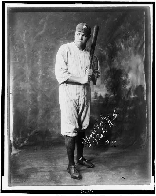[Babe Ruth, full-length portrait, standing, facing slightly left, in baseball uniform, holding baseball bat]