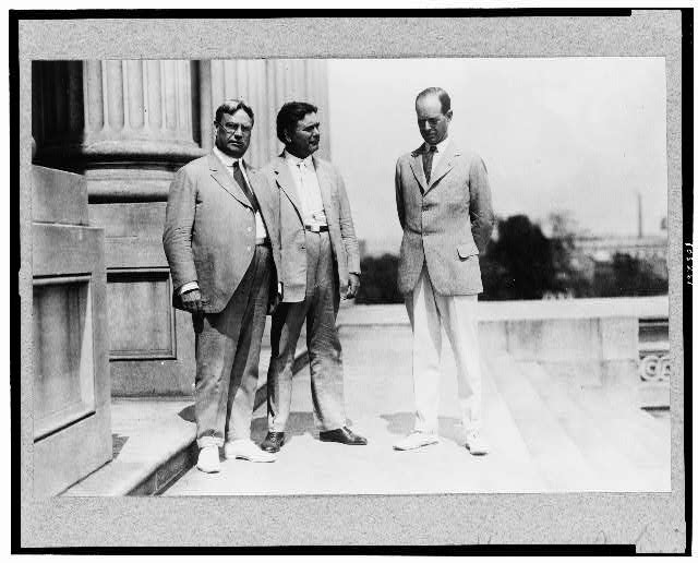 [Hiram W. Johnson standing with two other men outside the U.S. Capitol?]